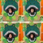 Dzieci na tle dinozaura